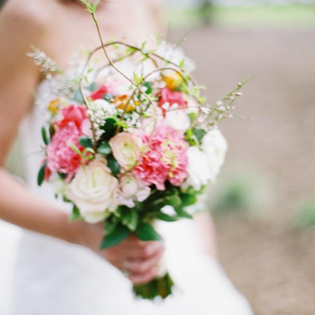 Lauren carried a larger version of the bridesmaid bunches; succulents and greens added a rustic feel.
