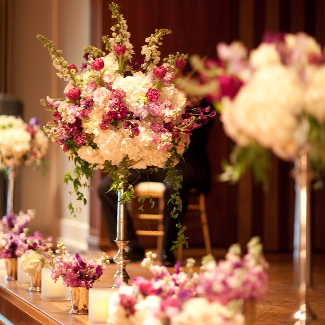 Large pink-and-white arrangements covered the ceremony stage and later decorated the reception.