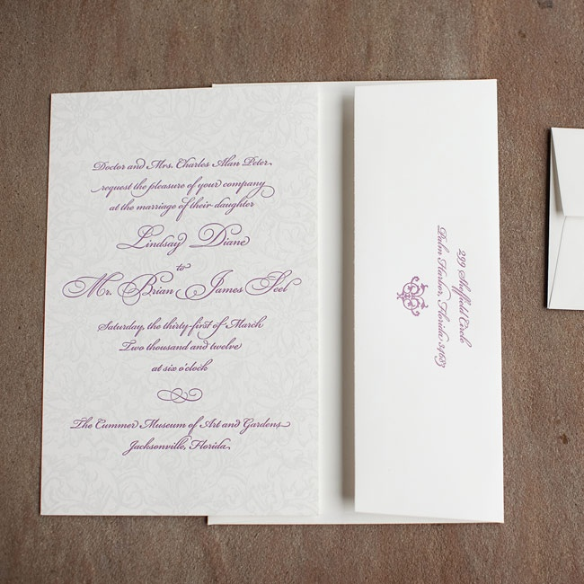 The elegant invitations featured an eggplant-colored font and a faint damask design in the background.