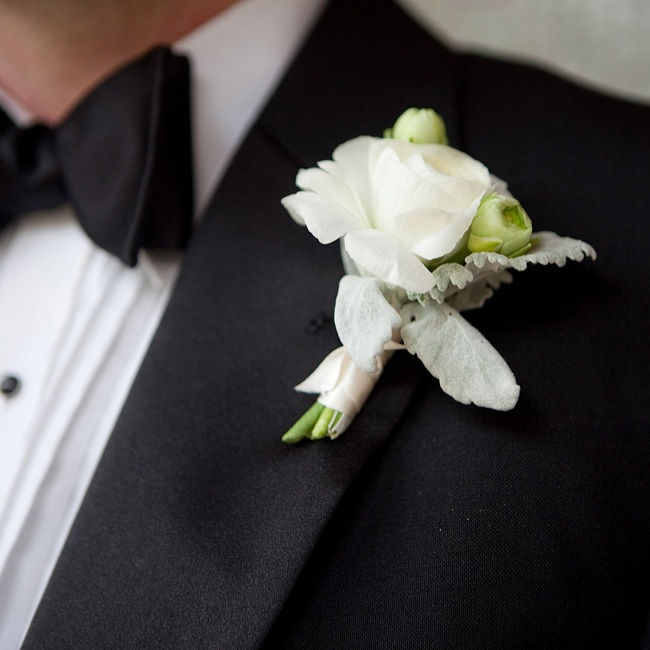 Brian wore a single white ranunculus bloom bordered with dusty miller.