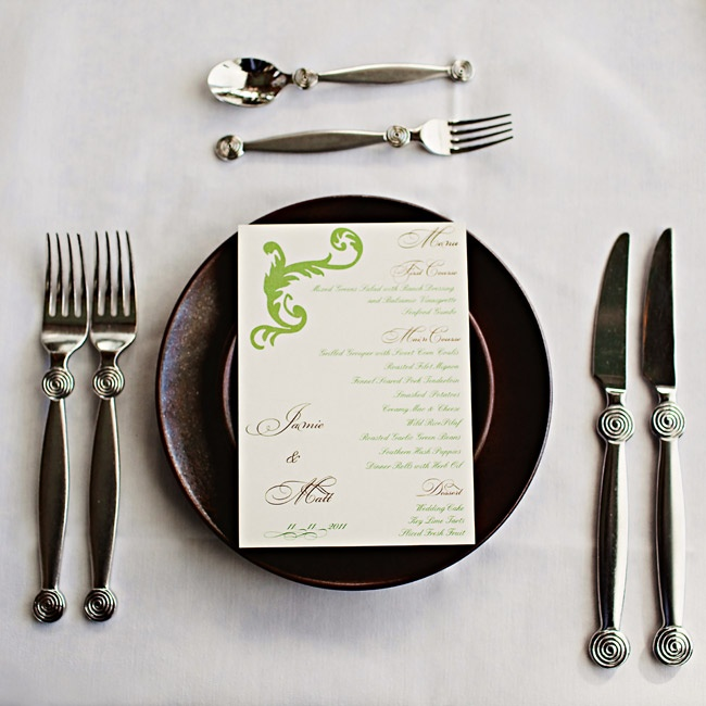 The dark-brown plates were topped with whimsically decorated green menu cards.