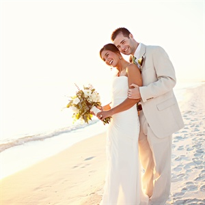 For their destination wedding, Jamie wore a beachy gown with ruching and an off-center slit, while Matt chose a relaxed ivory-colored linen suit.