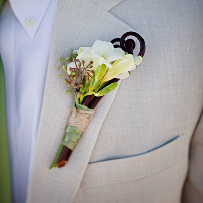 Matt wore white blossoms with a fiddlehead fern stem.