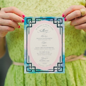 A black geometric border, paired with pretty watercolor designs, made for unique menu cards.