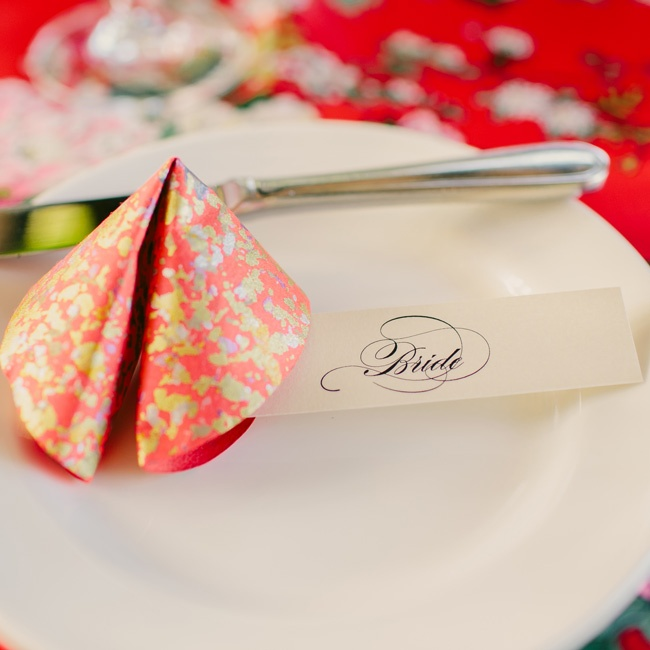 Guests found their seats with oversize, colorful paper fortune cookies.