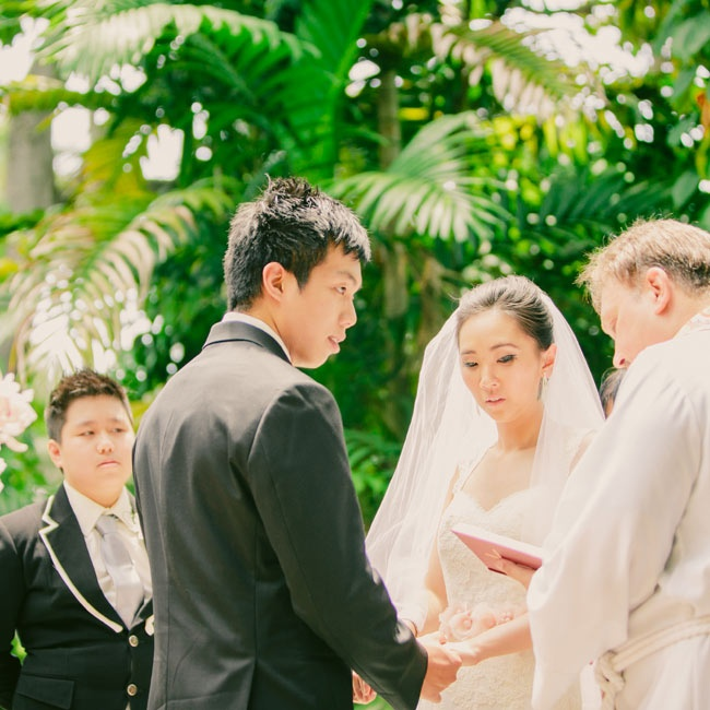 The couple wed outdoors under a giant banyan tree in the garden of an ancient Spanish monastery.