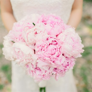 Julia carried a ruffled, round bunch of pink peonies.