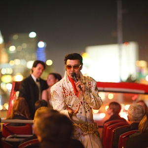 "After the meal the couple arranged for Elvis to make a surprise appearance!  The guests were so shocked to see Elvis saunter up to their able.  He then escorted everyone back to the open-top double-decker bus. Elvis sang and danced as the couple celebrated with the lights of Las Vegas as the backdrop. ""One of my favorite memories is all of our gues ..."