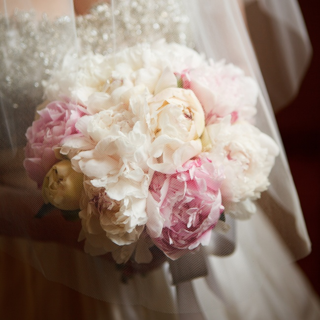 Peonies are Molly's favorite flower and the soft colors meshed with the old-fashioned tone of the wedding.