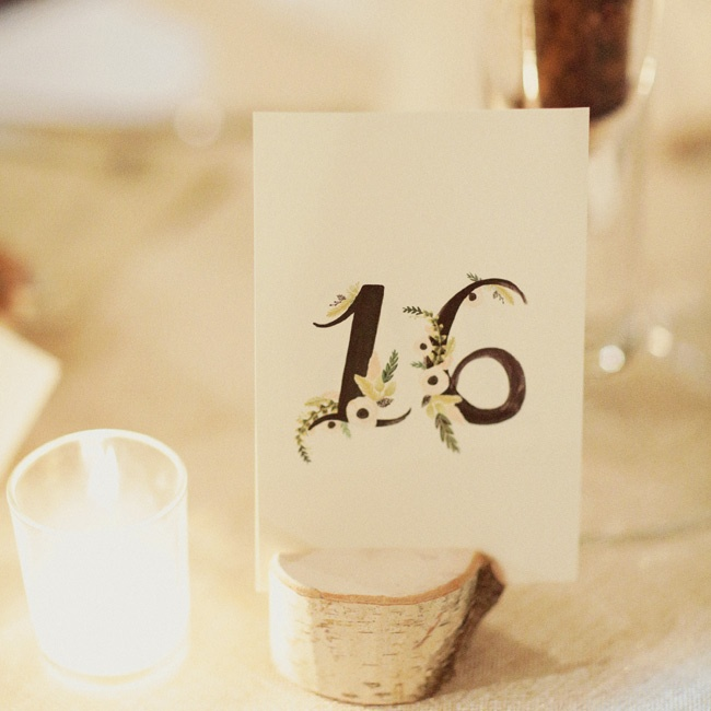 The table numbers were covered with whimsical painted flowers.