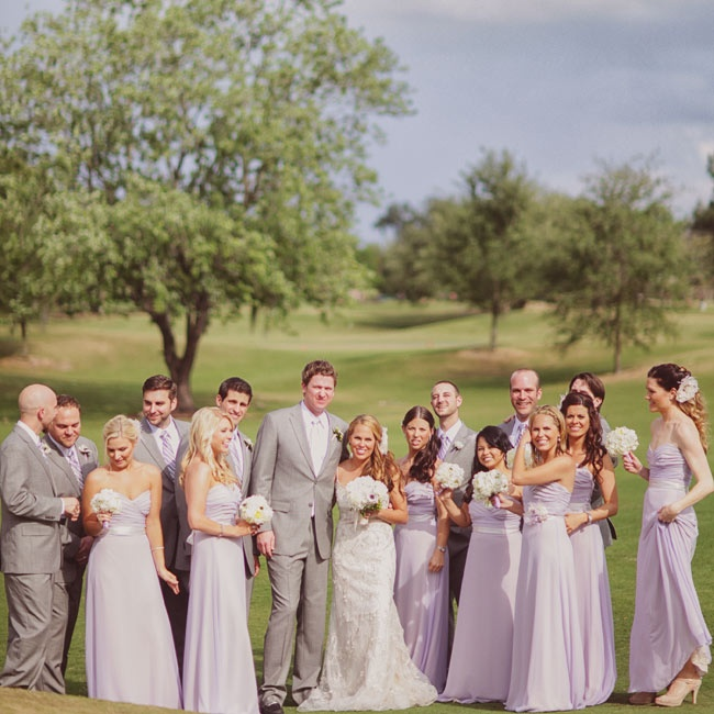 All the bridesmaids wore pale-purple floor-length gowns.