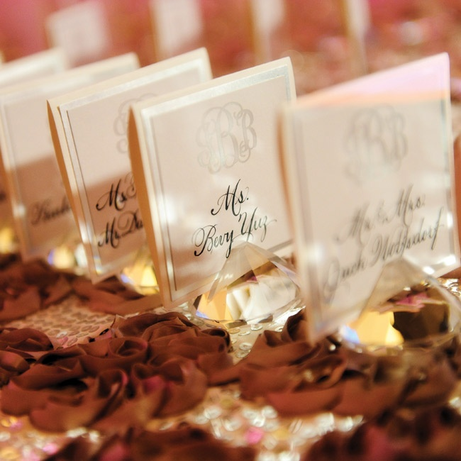 Elegant escort cards were displayed in crystal holders.