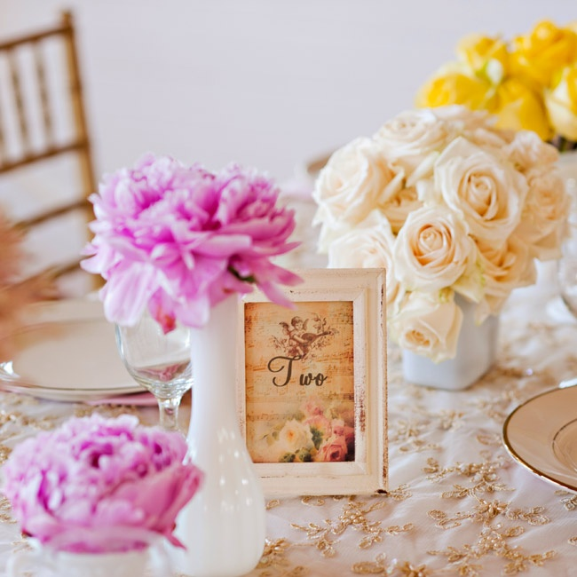 Printed on vintage-style cards, the table numbers were displayed in white antique-looking frames.
