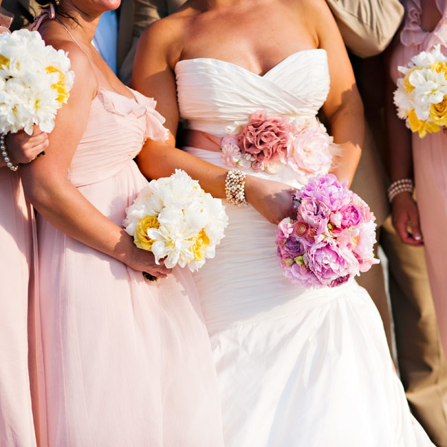 Kristina added a pink sash to her fit-and-flare gown for a personal touch.