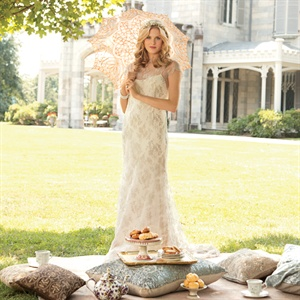 While the high neckline gives this gown a Victorian feel, the silver lace accents make it anything but old fashioned. Gown, $5,500, Rivini.com; headpiece, $245, TwigsandHoney.com; engagement ring, $6,500, Tacori.com; Carolee bracelet, $50, Macys.com; parasol, price upon request, Cultural Intrigue.com; pillows, from $80, and rug, $2,400, ABCHome.com ...