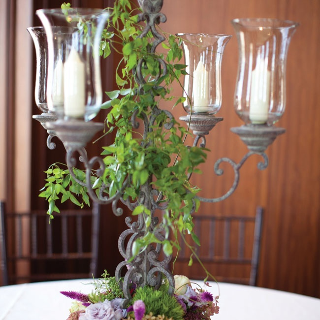 Tall candelabras were wrapped in leafy vines and added height to a few of the reception tables.
