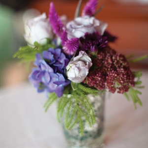 Roses, hydrangeas, greenery and purple veronicas were placed in mercury-glass vases and set on tables for the cocktail hour.