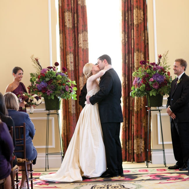 The ceremony space needed little extra décor. The couple's evening vows were flanked by two lush floral arrangements.