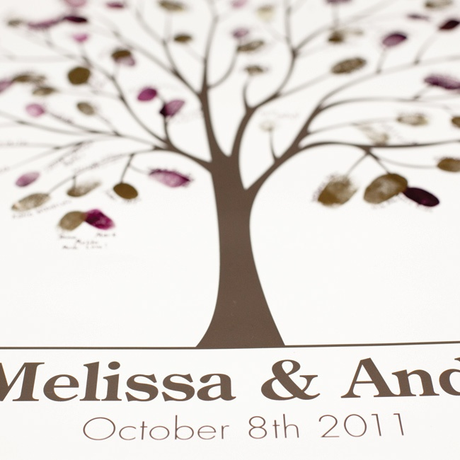 In lieu of a traditional guest book, friends and family signed their names next to their fingerprints on this custom tree design.