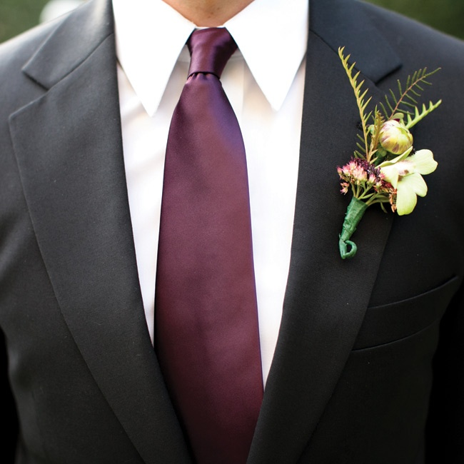The men wore dahlia bud and dendrobium orchid bouts accented with sprigs of fall foliage.