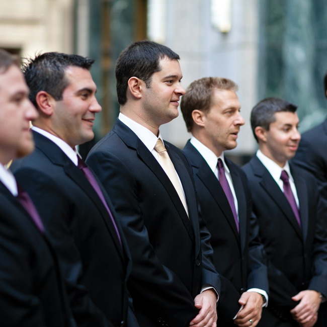 The guys wore black suits and eggplant ties - Andy stood out in a gold one.