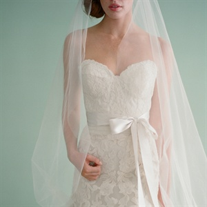 Gown, $5,490, and veil, $2,630, Liancarlo.com