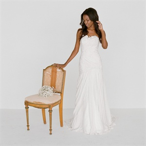 Gown, $3,600, TulleNewYork.com; ring, from $14,520, DemarcoJewelry.com