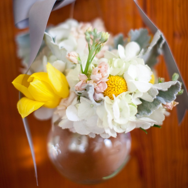 Small glass vases were filled with springtime blooms and hung from the ends of the chapel pews.