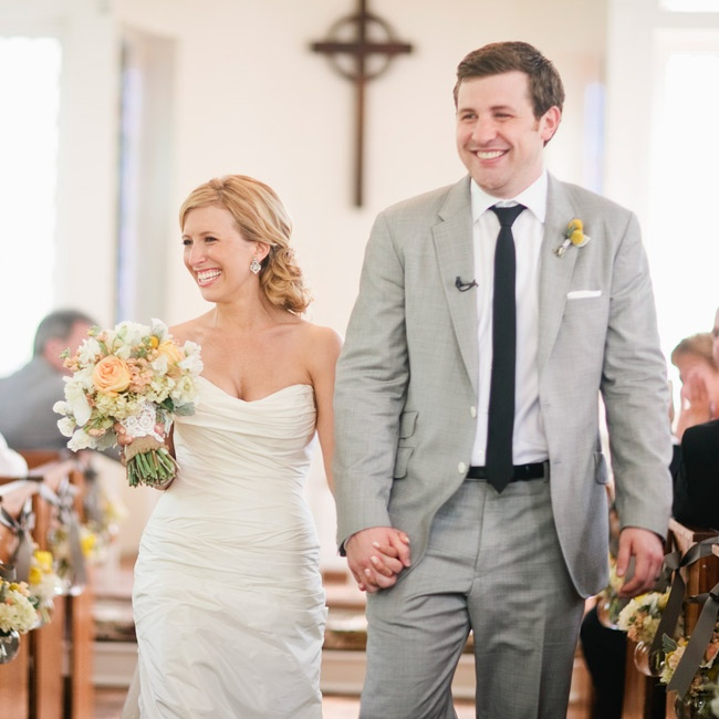 "The ruched, modified sweetheart neckline on the bride's gown was perfectly feminine for the self-proclaimed ""girly-girl."" Kevin chose a black skinny tie to go with his light-gray suit."