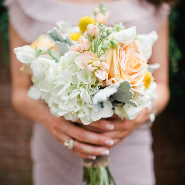 The girls carried pretty pastel bunches of hydrangeas, lamb's ear, craspedia and peonies.