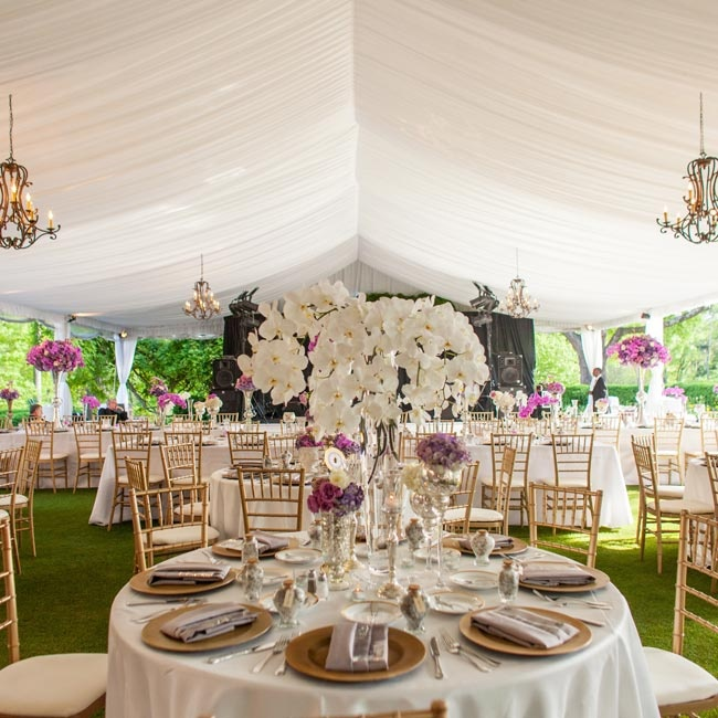 The elaborately draped tent was decorated with elegant chandeliers for a romantic effect.
