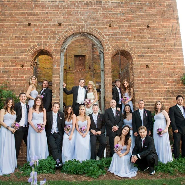 The bridesmaids all wore the same flowy pale-purple dress, while the guys were in classic black tuxes.
