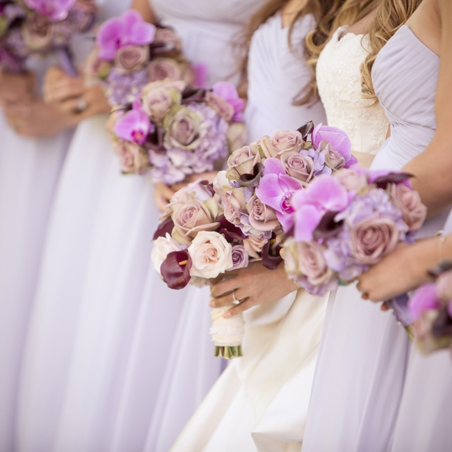 The girls carried smaller versions of Jenn's bouquet with added purple orchids.