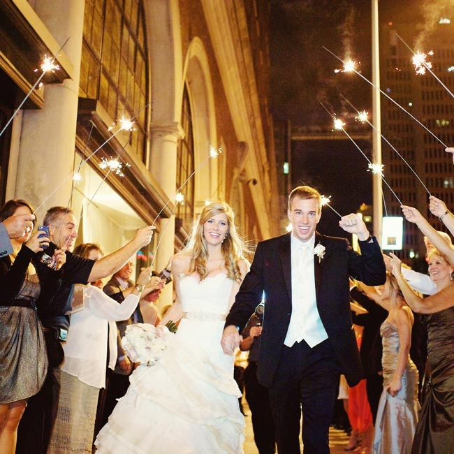 The couple left their reception through a tunnel of sparklers.