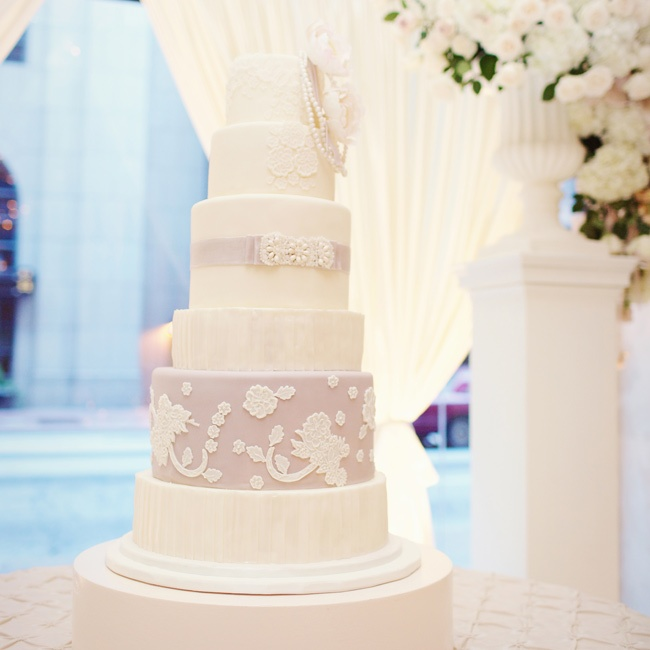 Each tier of the white and lavender cake was made to mimic a different detail from Heidi's wedding dress.