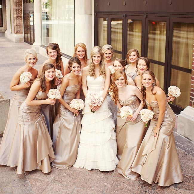 "The girls wore strapless taffeta dresses in a taupe hue called ""toast."""