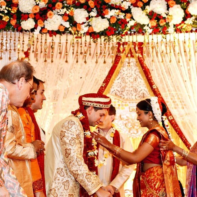 Shwetha and Jeff placed garlands around each other's neck to kickstart the Hindu ceremony. A large velvet banner that was held up in front of Jeff to block his view of Shewtha walking down the aisle, another Indian tradition.