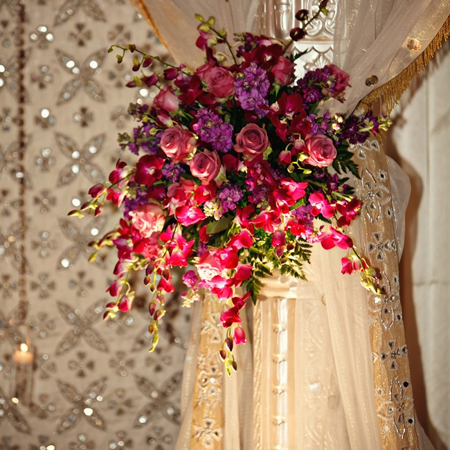 Purple roses, orchids and the like dressed each pillar of the huppah, which also matched the flowers of Shwetha's wedding bouquet.
