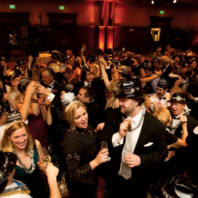 At midnight, everyone gathered on the dance floor with champagne and party hats.