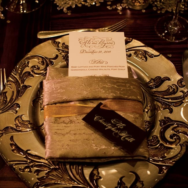 Guests sat down to ornate chargers decorated with gold napkins and menus.