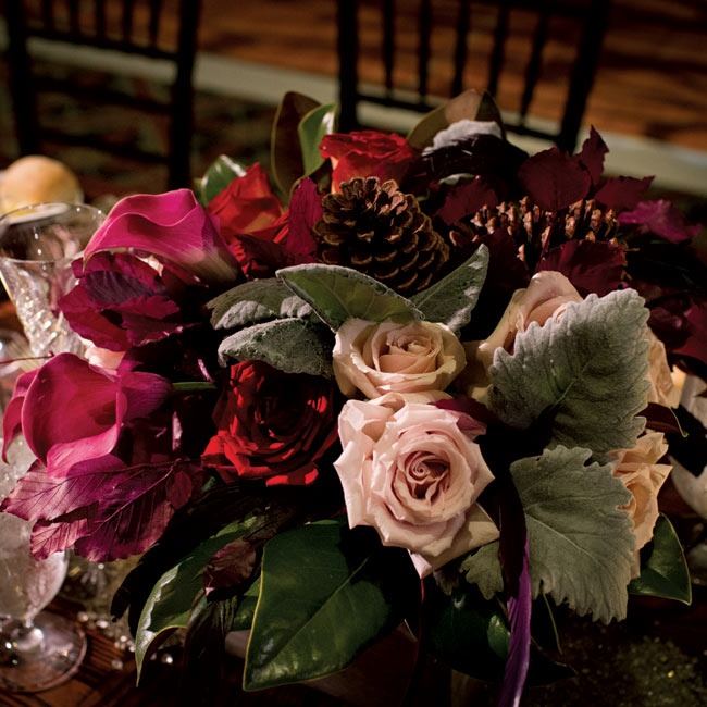 Low centerpieces were overflowing with deep-hued roses and calla lilies.