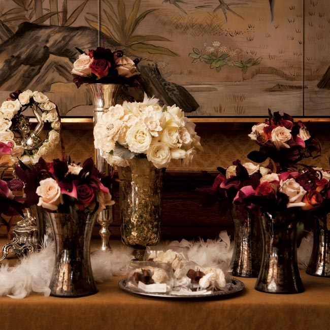Displays of mercury-glass vases filled with roses and calla lilies spotted the décor.