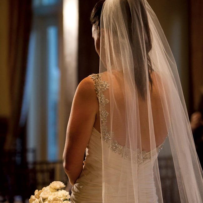 Ali wore her hair in a high pony with her veil tucked in for a natural look that fit her everyday style.
