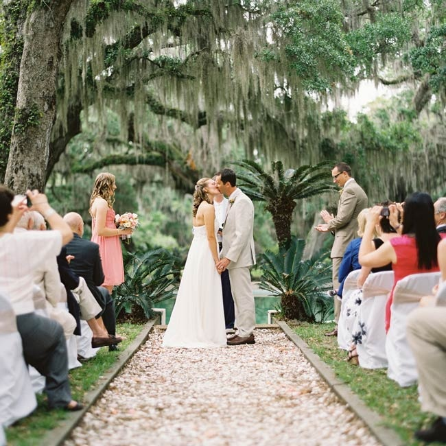 The Spanish moss and lagoon that served as the day's backdrop inspired the wedding theme.