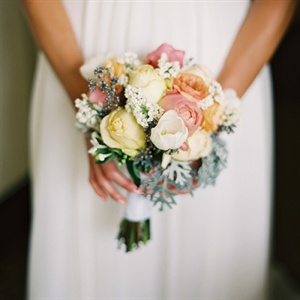 Allie carried a springy bunch of ranunculus, roses and tulips.