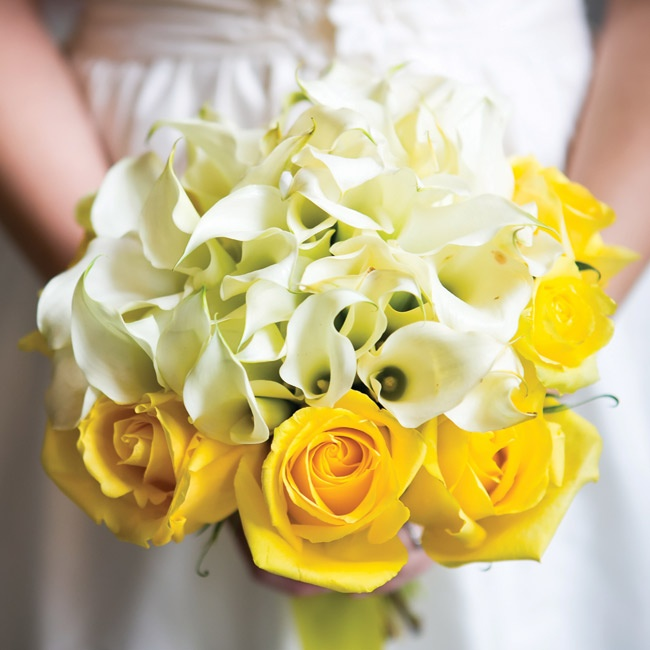 Sam's white calla lilies got a boost of color from a ring of yellow roses.