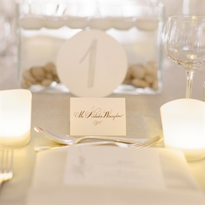 Each guest's seat was marked by a simple calligraphed white tented card. The table numbers were hand-stamped onto white paper circles.