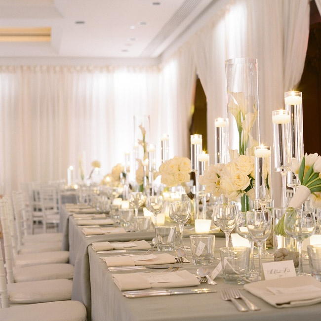 Shimmery pewter linens and clean, architectural centerpieces of white roses, calla lilies and hydrangeas made for an elegant look.