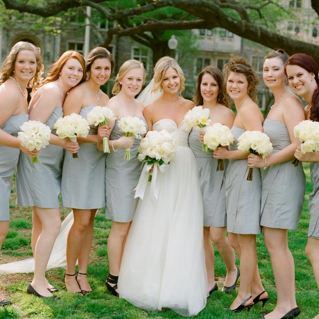 Freddy's eight bridesmaids wore the same strapless slate-gray taffeta dress.