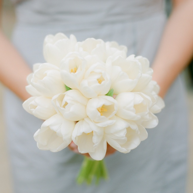 Half of the girls carried bunches of white tulips.